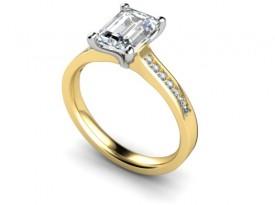 18 Carat Yellow and White gold Emerald cut Diamond and diamond set shoulders