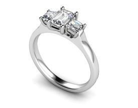 18 Carat White gold 7mm x 5mm Emerald cut and 4mm Princess cut Diamond Ring..