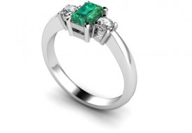 18 Carat White gold 7mm x5mm Octagon Emerald and Diamond Ring