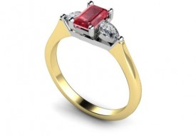 18 Carat Yellow and White gold Emerald cut Blood red Ruby and pear shaped Diamond Ring