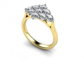 18 Carat Yellow and White gold 9 stone Diamond Boat shaped Ring..